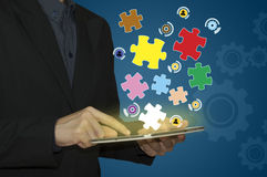 Business man with jigsaw puzzle piece. Success word on puzzle piece Stock Photo