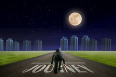 Business man JOURNEY line in front of city. Night back view. Con Royalty Free Stock Photos