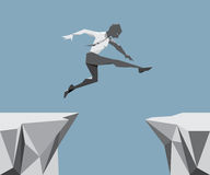 The Business Man Jump across the chasm. Stock Images