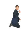 Business man  jump and gives thumbs Stock Photo