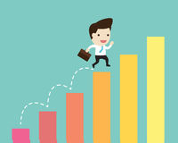 Business man jump over growing chart in flat design Stock Images