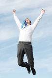 Business man jumping Stock Images