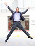 Business man jumping Stock Photos