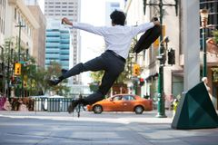 Business Man Jumping in Air Royalty Free Stock Photos