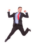 Business man jumping with his hands in the air Royalty Free Stock Images
