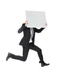 Business man jumping and holding billboard Stock Photography