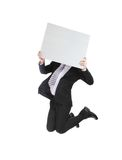 Business man jumping and holding billboard Royalty Free Stock Photography