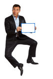 Business man jumping holding showing whiteboard Stock Photo