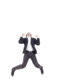 Business man jumping of joy and success isolated over a white ba Stock Images