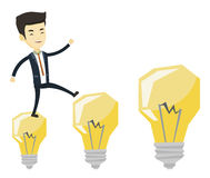 Business man jumping on light bulbs. Royalty Free Stock Photo