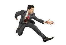Business man jumping and running forward Stock Images