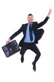 Business man jumps and points with suitcase Stock Photo