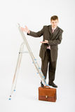 Business man with ladder Royalty Free Stock Photo