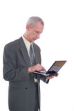 Business man and laptop. Photograph showing business type male with laptop computer isolated Royalty Free Stock Images