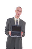 Business man with laptop. Photograph showing business type male with laptop computer isolated Stock Images