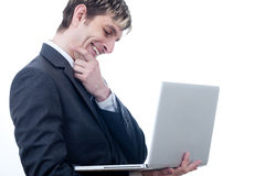 Business man with a laptop Stock Image