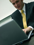 Business man with laptop 2 royalty free stock images