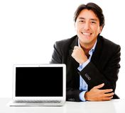 Business man with a laptop Stock Images