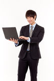 Business man and laptop. Stock Image