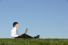 Business man on a laptop Royalty Free Stock Images