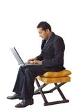 Business man laptop on a chair - je Stock Photography
