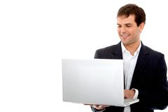 Business man on a laptop computer Stock Images