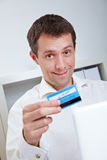 Business man with laptop and credit Stock Image