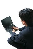 Business man laptop - (focus on laptop) Royalty Free Stock Photos