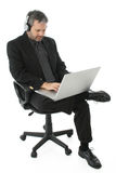 Business Man with Laptop and Headphones stock image