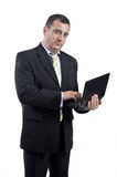 Business man with a laptop in his hands. Isolated on white stock photography