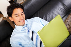 Business man on a laptop at home Royalty Free Stock Photography