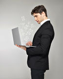 Business man with laptop and mail icon. Business man with laptop in hand and mail icon over grey background Royalty Free Stock Image