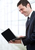 Business man  with laptop in office Royalty Free Stock Photos