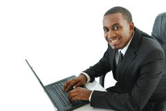 Business man with laptop. Business man sitting with a laptop looking up Stock Photo