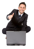 Business man on laptop with thumbs up Stock Image