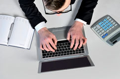 Business man at laptop Stock Images