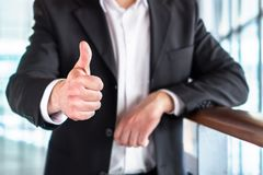 Business man or lawyer giving thumbs up. royalty free stock photography