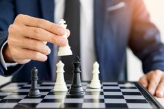 Business man leader of a successful business holding the chess i. N hand Digital composite of Chess pieces Stock Images