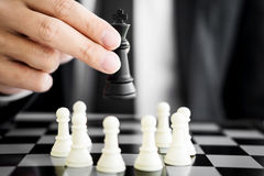 Business man leader of a successful business holding the chess. In hand Digital composite of Chess pieces Stock Photos
