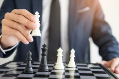 Business man leader of a successful business holding the chess i. N hand Digital composite of Chess pieces Stock Photos
