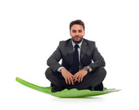 Business man on the leaf Stock Images