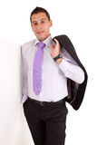 Business man leaning against wall Royalty Free Stock Photo