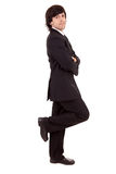Business man leaning against wall Stock Image