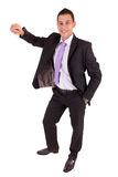 Business man leaning against wall Royalty Free Stock Photos