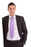Business man leaning against wall Stock Images