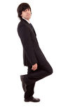 Business man leaning against wall Stock Photo