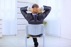 Business man leaning back in the chair Stock Photos