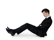 Business man leaning floor Stock Photo