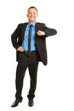 Business man leaning on imaginary corner Royalty Free Stock Image