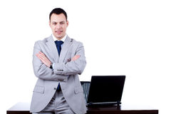 Business man leaning on office desk Royalty Free Stock Images